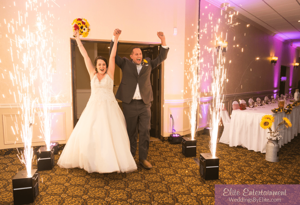 Bride and groom with arms raising in the air celebrating